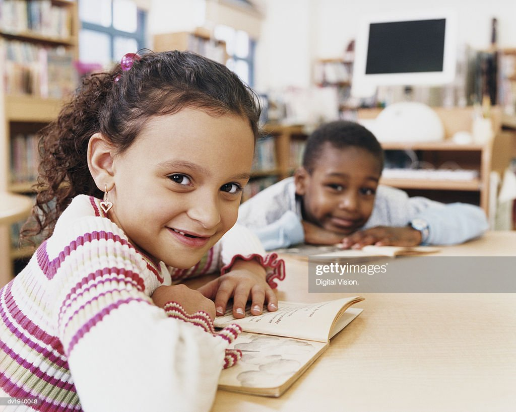 Young Children Reading Books in a Classroom : Stock Photo