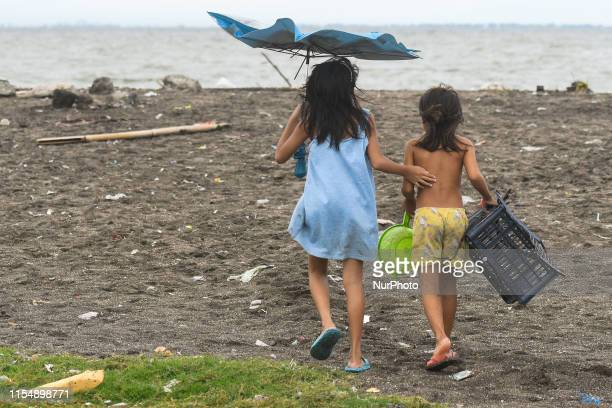Young children seen on the beach in Manila Bay near Baseco Compound The Batangas Shipping and Engineering Company Compound is the largest among five...