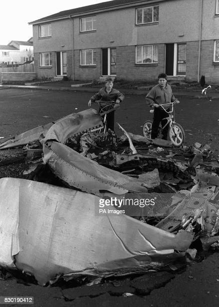 Young children survey wreckage of the PAN AM Boeing 747 jumbo jet which crashed on the Scottish town of Lockerbie near Dumfries the night of 21/12/88...