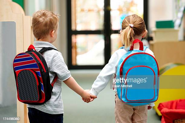 young children walking to school - preschool building stock pictures, royalty-free photos & images