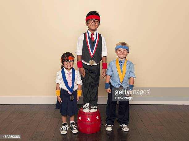 Young Children wearing Medals from Office Competition