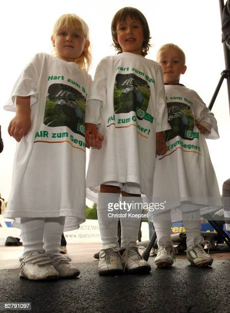 Young children wearing shirts of a campaign Tought against yourself fairplay to your enemy of the German Football association pose before the 2nd...