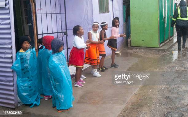 Young children welcome Bill and Melinda Gates as they visit the township of Khayelitsha on October 25 2019 in Cape Town South Africa The worlds...