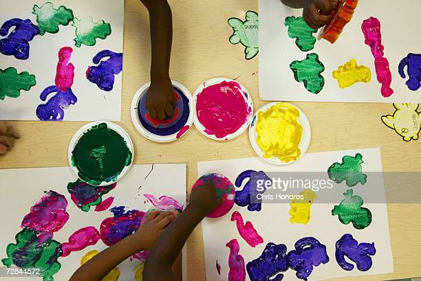 Young children work on a paint project at the 4 Kids Early Learning Center August 24 2004 in Braddock Pennsylvania The center is funded mostly by The...