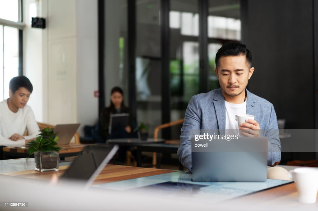 young chinese business people working with laptop : Stock Photo