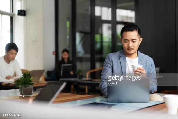 young chinese business people working with laptop - working stock pictures, royalty-free photos & images