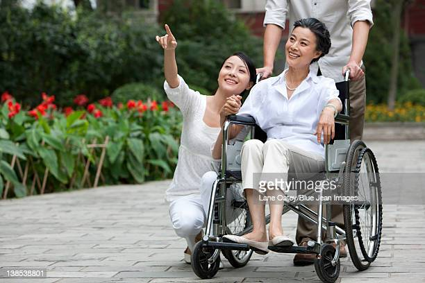 Young Chinese couple with senior mother