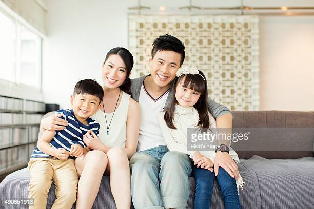 young chinese family in apartment - east asian culture stock photos and pictures