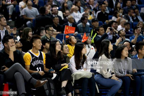A young Chinese fans waves the Chinese flag during a preseason game between the Los Angeles Lakers and Brooklyn Nets as part of 2019 NBA Global Games...