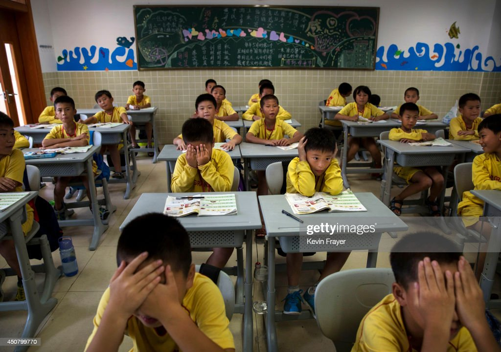 Young Chinese football players attend classes after training at the Evergrande International Football School on June 13, 2014 near Qingyuan in Guangdong Province, China. The sprawling 167-acre campus is the brainchild of property tycoon Xu Jiayin, whose ambition is to train a generation of young athletes to establish China as a football powerhouse. The school is considered the largest football academy in the world with 2400 students, more than 50 pitches and a squad of Spanish coaches through a partnership with Real Madrid.