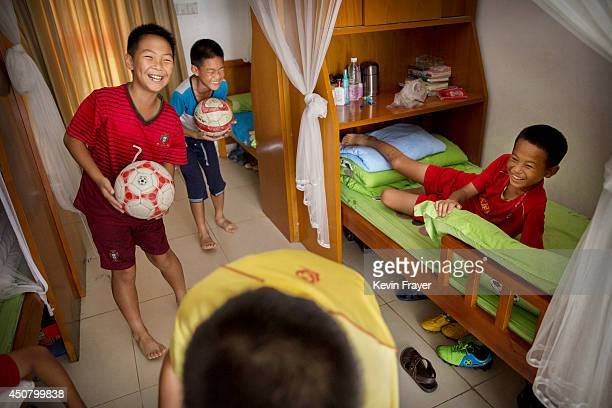 Young Chinese football players laugh together in their residence dormitory at the Evergrande International Football School on June 13 201 The...
