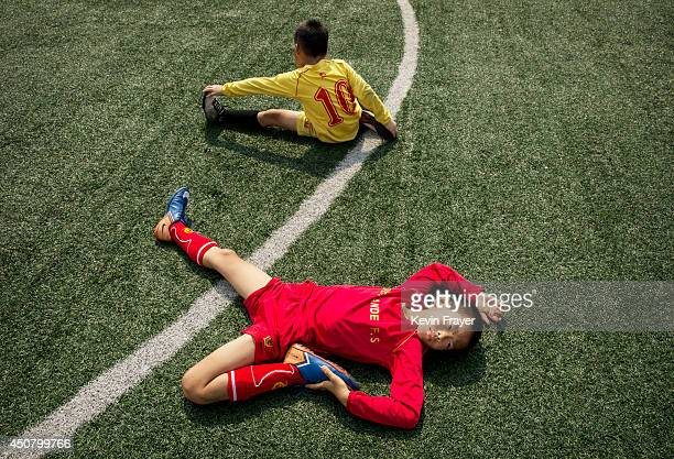 Young Chinese football stretch during training at the Evergrande International Football School on June 13 2014 near Qingyuan in Guangdong Province...