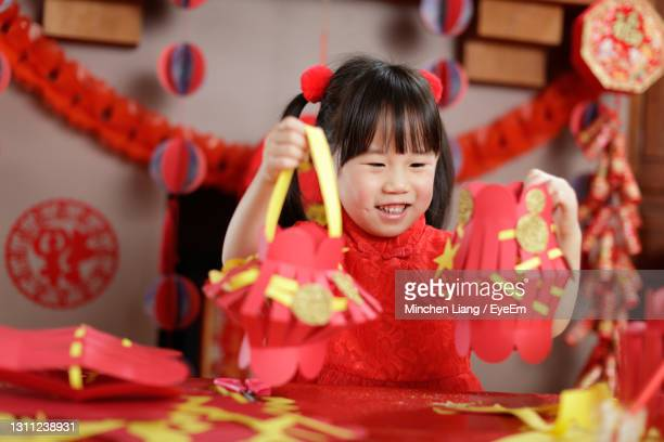 young chinese girl with traditional dressing up celebrate chinese new year - flower moon stock pictures, royalty-free photos & images