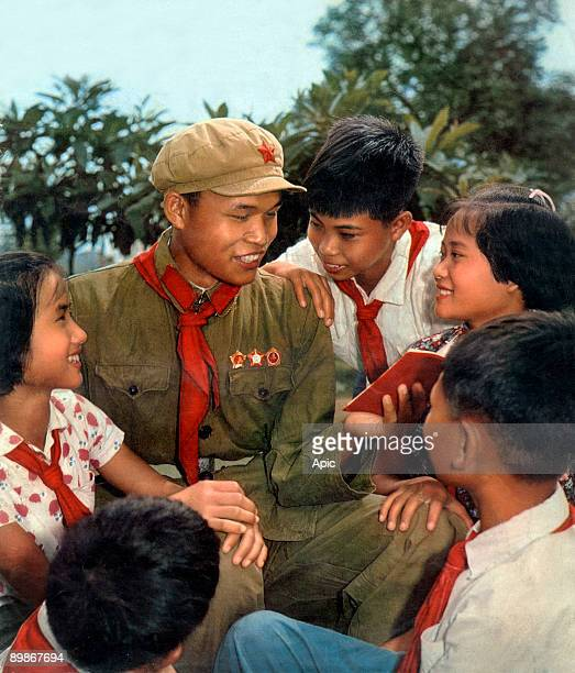 Young chinese listening Lieou Houaian extracurricular instructor talking about The Little Red Book 1966