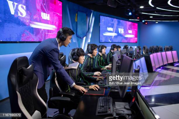 young chinese man coaching gamer playing esports - esports stock pictures, royalty-free photos & images