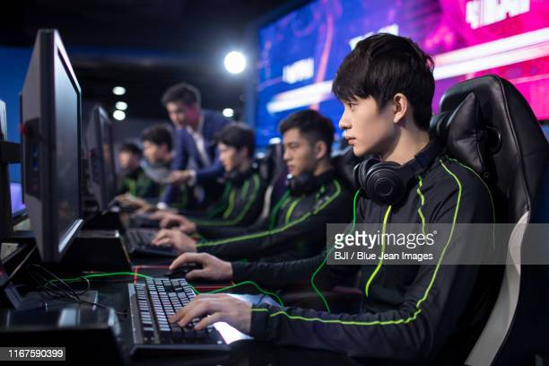 young chinese men playing esports - esports stock pictures, royalty-free photos & images