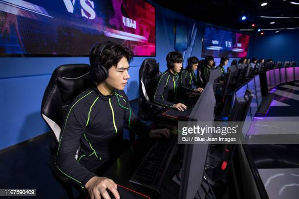 young chinese men playing esports - visual china group stock pictures, royalty-free photos & images