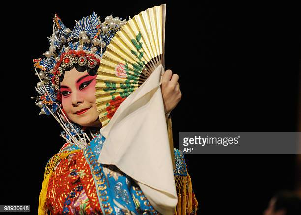 A young Chinese opera performer from the Anhui art college performs during a rehearsal for a Peking Opera performance at their school in Hefei...