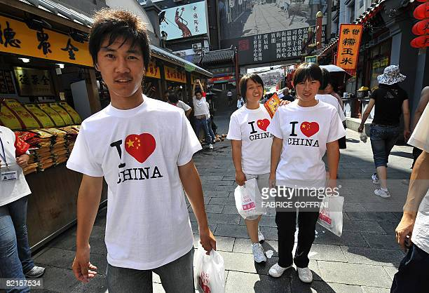 Young Chinese people wearing the same tshirt visit a food market in the centre of Beijing on August 2 2008 A dress rehearsal for the Olympics opening...