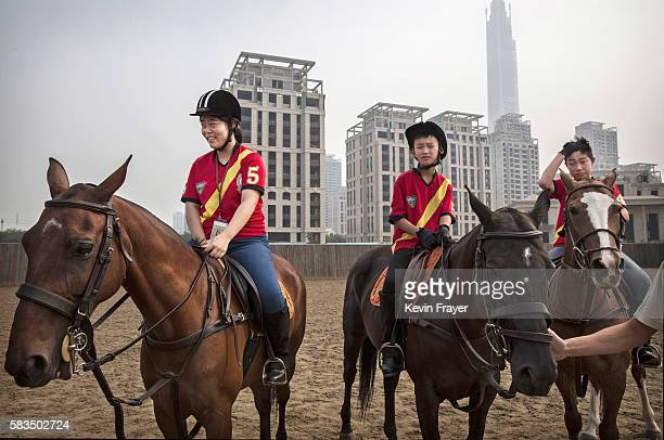 Young Chinese polo players from the Junior Polo Programme learn riding skills during a summer training camp at the Tianjin Goldin Metropolitan Polo...