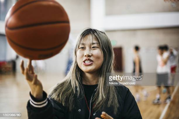 young chinese woman basketball player - women's basketball stock pictures, royalty-free photos & images