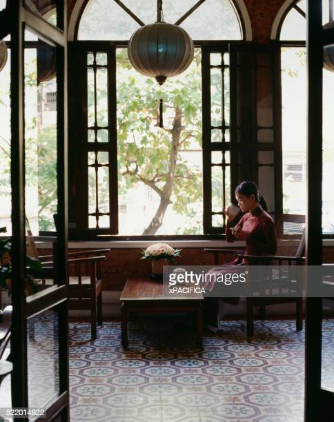 Young Chinese Woman Drinking Tea
