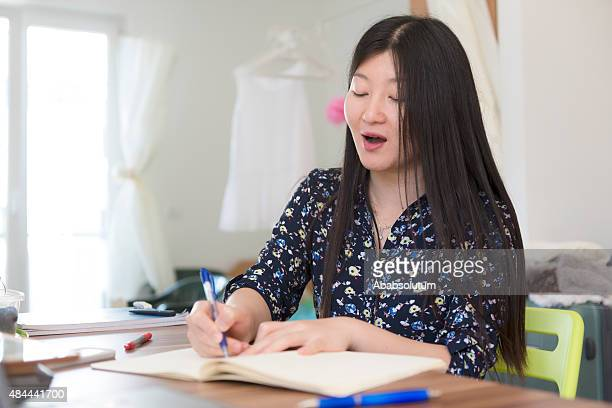Young Chinese Woman Studying at Home, Koper, Slovenia, Europe