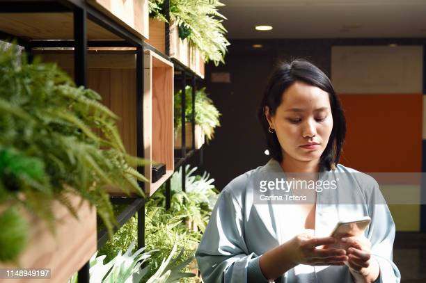 Young Chinese woman using a smart phone