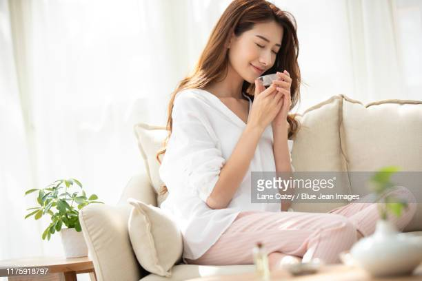 young chinese woman with natural aloe vera at home - one young woman only stock pictures, royalty-free photos & images