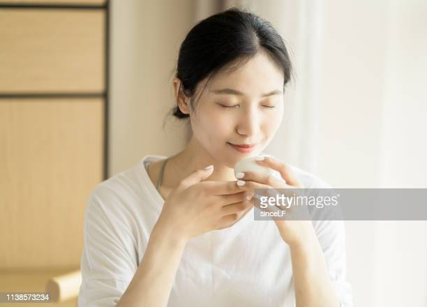 young chinese women are drinking tea - hot women pics stock pictures, royalty-free photos & images