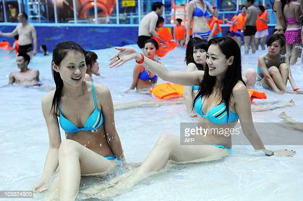 Young Chinese women play in the water in the newly relaunch National Aquatics Center better known as the Water Cube in Beijing on August 8 2010...