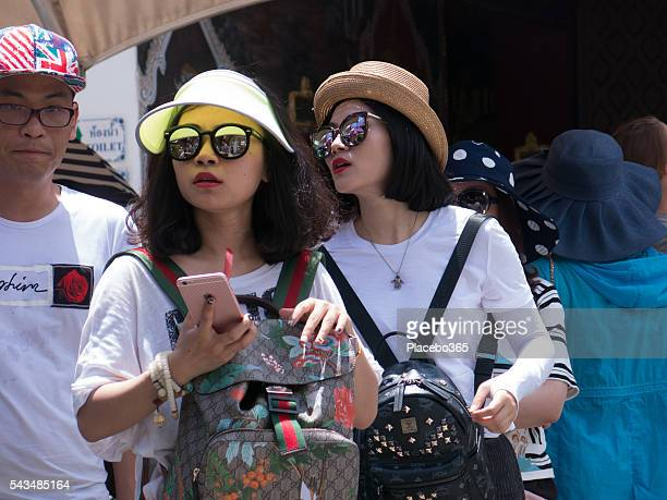 Young Chinese Women Selfie Mobile Phone and Man