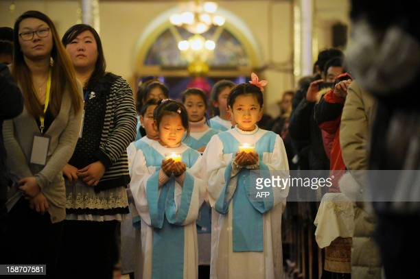 Young Chinese worshippers attend the Christmas Eve mass at a Catholic church in Beijing early on December 25 2012 While China does not officially...