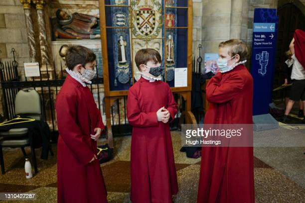 Young choristers wear masks as they prepare for the the Good Friday morning choral service, which took place without members of the public present...