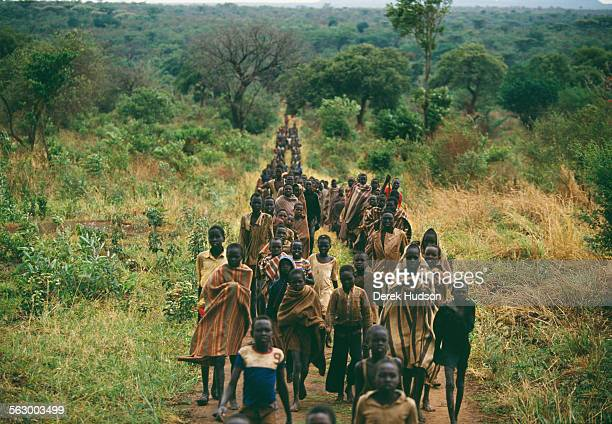 Young Christian children who fled the civil war in the Sudan arrive at an abandoned Catholic mission near Palotaka South Sudan Two hundred kilometres...