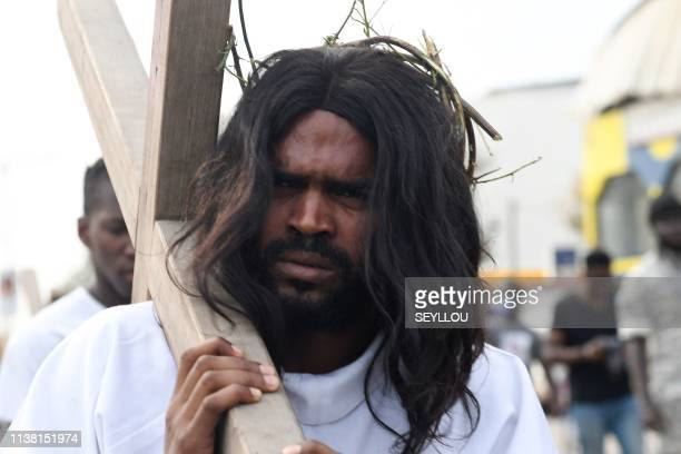 Young christian men take part in a representation of the Way of the Cross and the crucifixion of Jesus Christ in Saint Joseph De Medina parish in...