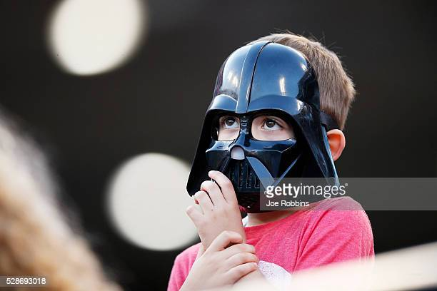 A young Cincinnati Reds fan sports a Darth Vader mask on Star Wars Night during the game against the Milwaukee Brewers at Great American Ball Park on...
