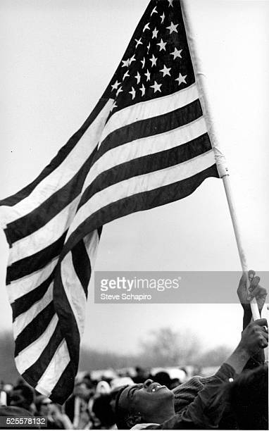 Young civil rights activist waves an American flag during the Selma to Montgomery Civil Rights Marches There were three march attempts the first was...