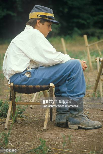 young Civil War participant in camp scene during recreation of Battle of Manassas Virginia
