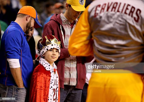 A young Cleveland Cavaliers fan looks on as LeBron James warms up prior to a game against the Boston Celtics at TD Garden on November 14 2014 in...
