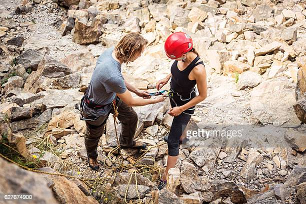 Young climbers checking their equipment
