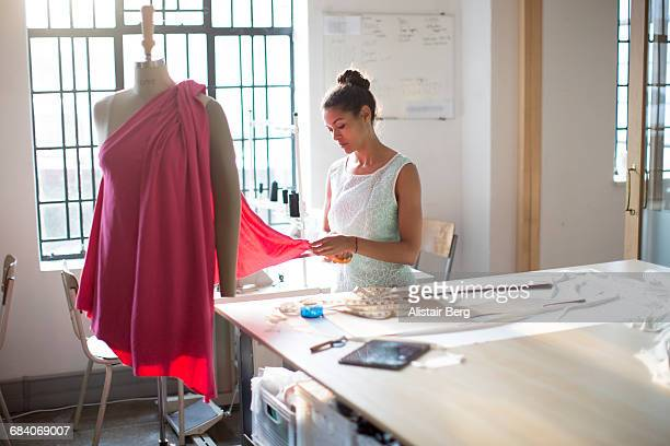 young clothes designer in her studio