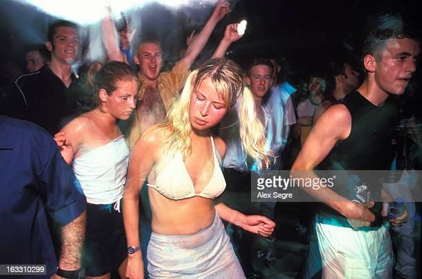 Young clubbers dancing at Privilege nightclub in Ibiza