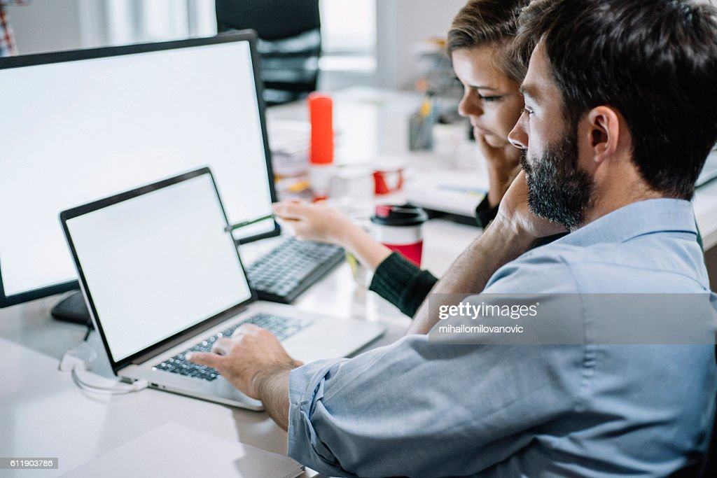 Young colleagues working on a project : Stock Photo