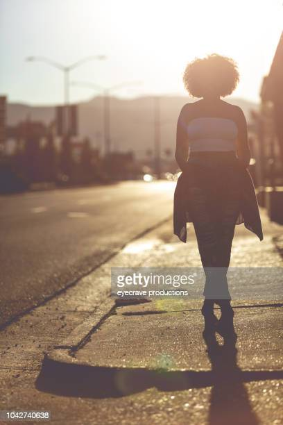 Young College Age Ethnic Female Student On Urban American Street at Sunset