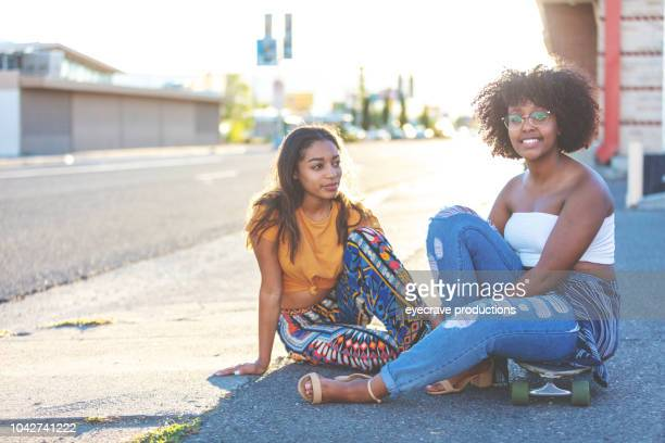 Young College Age Ethnic Female Students On Urban American Street at Sunset