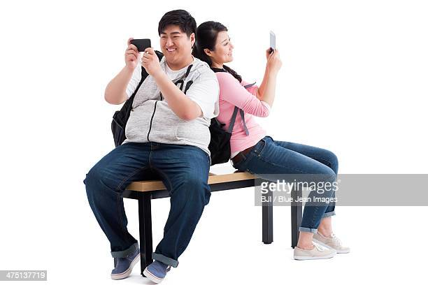 Young college couple with mobile phone