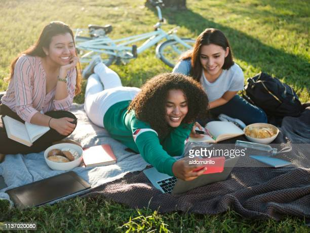 young college girls taking a selfie - mexican picnic stock pictures, royalty-free photos & images