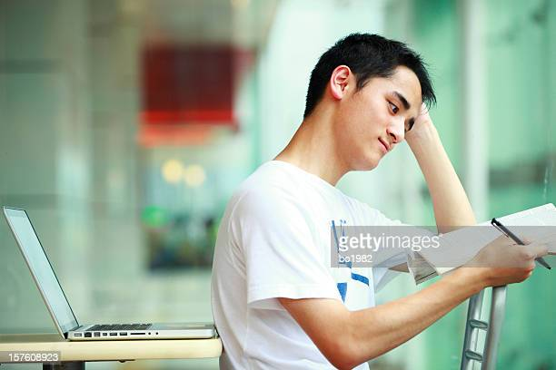young college student reading book