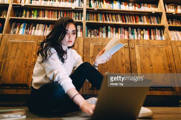 young college student studying at library - one young woman only stock pictures, royalty-free photos & images